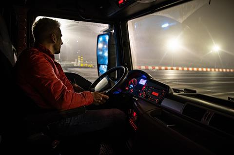 Lorry driver at night