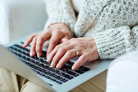 elderly woman on laptop computer online