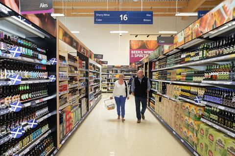 tesco shoppers in alcohol aisle