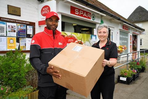 DPD driver posing with Enham Alamein Postmistress Leslie Francis
