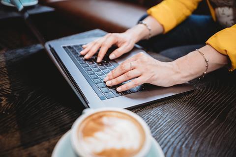 Woman on laptop computer coffee